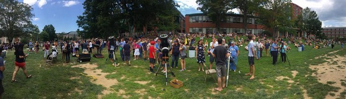 Telescopes set up on Sanford Mall with crowd of students surrounding them