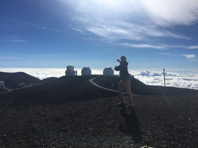 Tucker posing with Keck I and II in the background, Mauna Kea