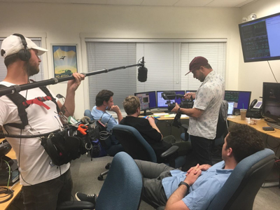 Tucker and the the film crew (including visiting microbiologist Luke McKay) discuss observing at Keck II Headquarters, Waimea