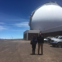 Smith and Tucker standing in front of Keck Observatory entrance, Mauna Kea