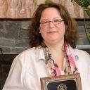 Dr. Jennifer Burris receiving Durham Freshman Advocate Award